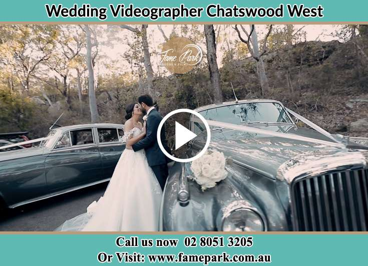 Bride and Groom looking at each other beside their bridal car Chatswood West NSW 2067