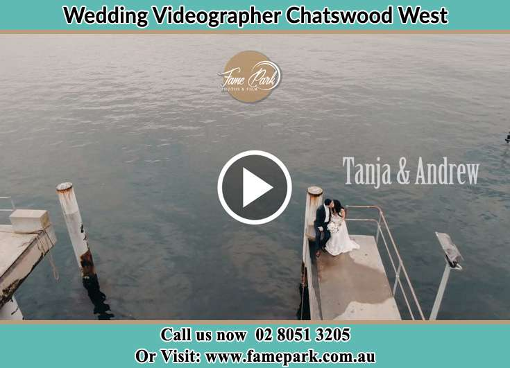 Bride and Groom kissed at the bay while sitting Chatswood West NSW 2067