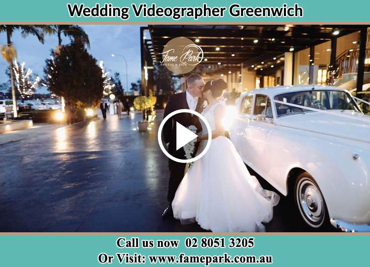 The new couple kissing near the wedding car Greenwich NSW 2065