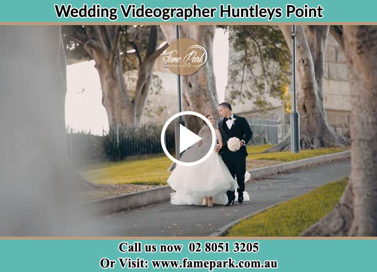 The Groom and the Bride walking in the street Huntleys Point NSW 2111