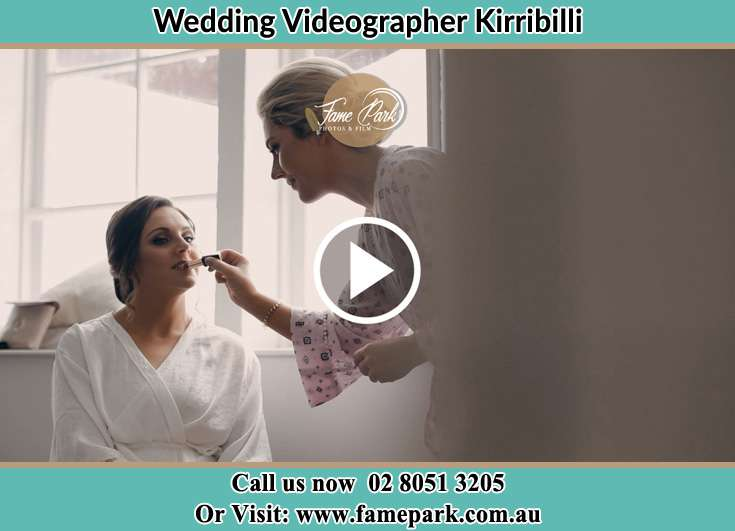 A woman applying lipstick to the Bride's lips Kirribilli NSW 2061