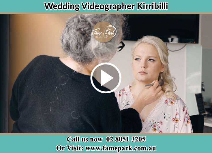 A woman applying makeup to the Bride's face Kirribilli NSW 2061