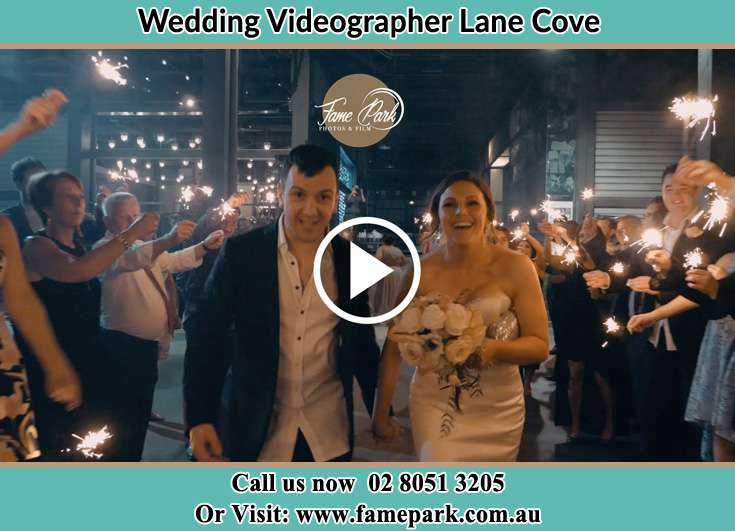 The Groom and the Bride walking though a festive crowd Lane Cove NSW 2066