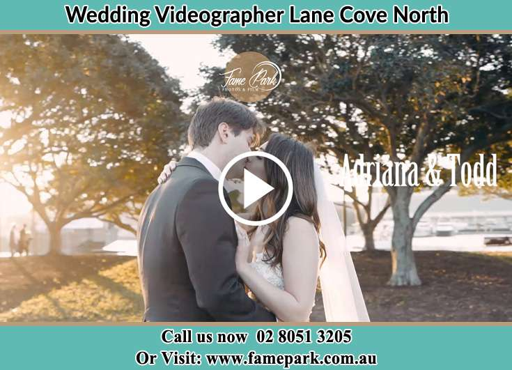 The newlyweds kissing in the park Lane Cove North NSW 2066