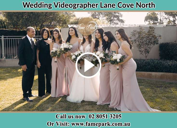 The Bride and her family with the bridesmaids pose for the camera Lane Cove North NSW 2066
