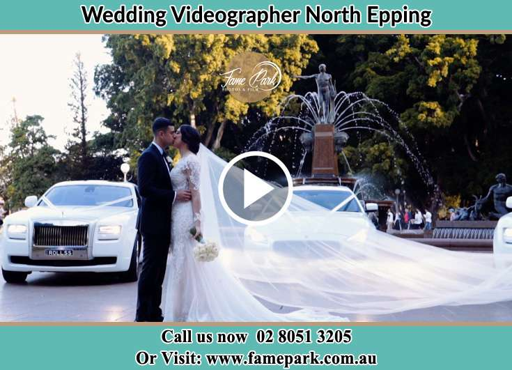 The new couple kissing near their wedding car North Epping NSW 2121