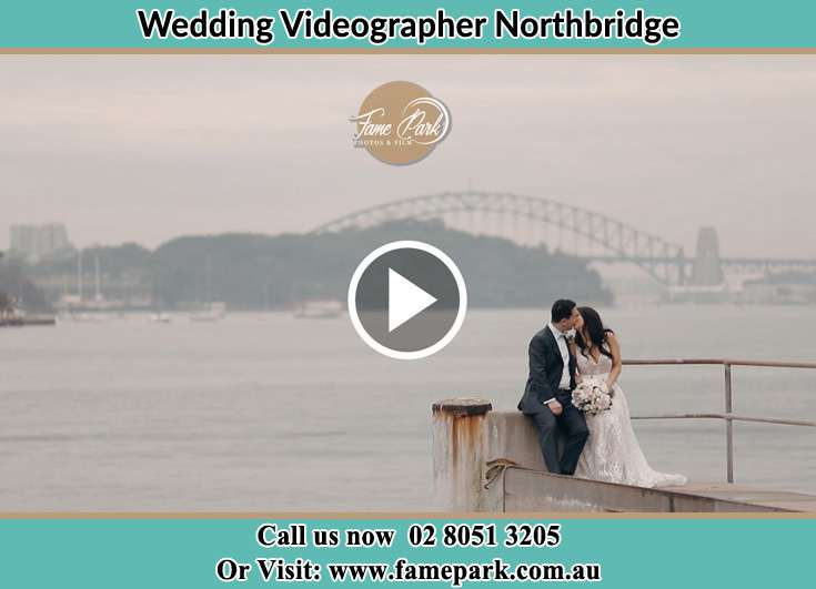 Bride and Groom kissed at the shore while sitting Northbridge NSW 2063