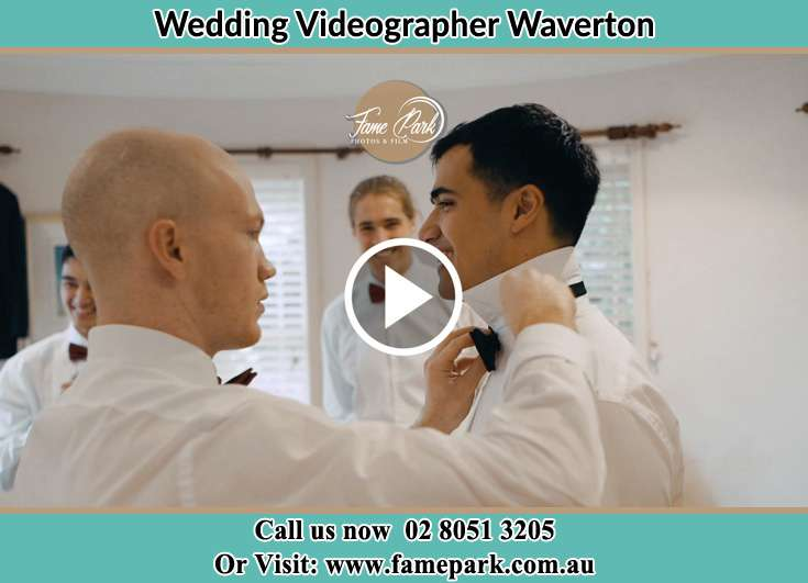 The best man assisting the groom on his bow tie Waverton NSW 2060